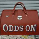 Absolute Sign solutions can handpaint anything onto anything you require. We are experts in signwriting handpainted sports bag for sportsbet booky by absolute sign solutions Australia