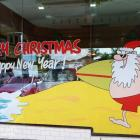 Absolute Sign Solutions do awesome handpainted christmas windows and promotional signage handpainted christmas windows by Absolute Sign Solutions Sydney Australia
