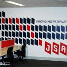 Large handpainted logo to office wall by Absolute Sign Solutions - Sydney Large logo handpainted to gyprock wall by Absolute Sign Solutions Australia