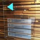 We can supply and install high quality and creative directory signs to your office reception walls Clear acrylic directory board to timber slat wall by Absolute Sign Solutions Sydney Signmakers Australia