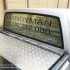 Signs for trades vehicles Sydney Trade ute with perforated print by Absolute Sign Solutions Australia